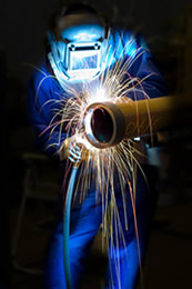 Operator performing plasma cutting