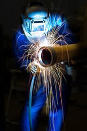 Operator performing plasma cutting